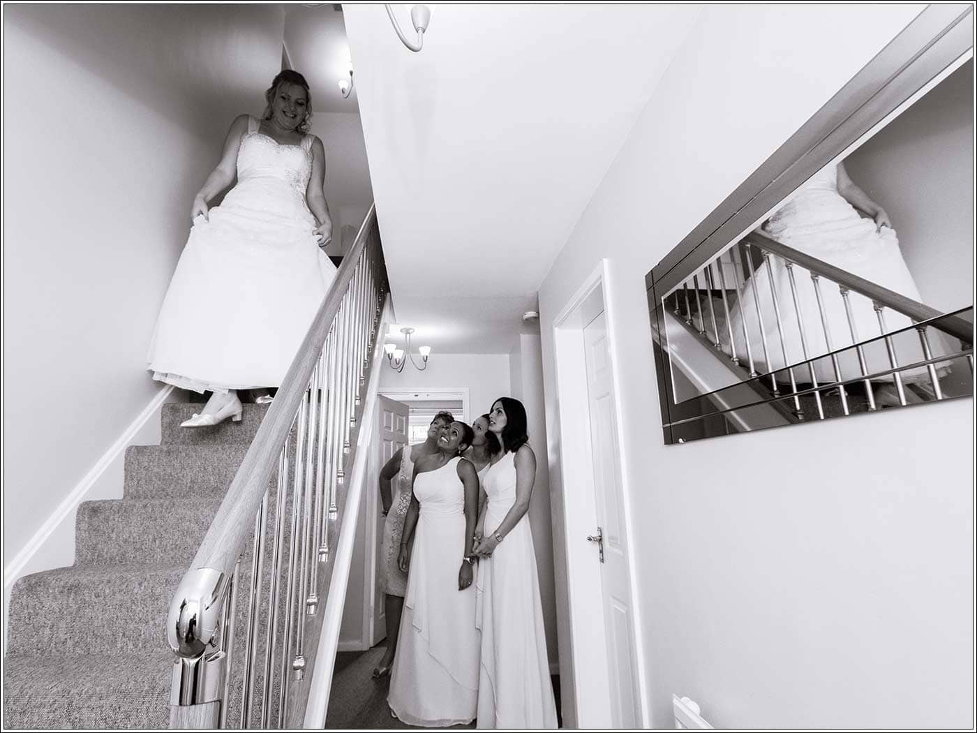 Bride decending stairs before her Walton Hall wedding