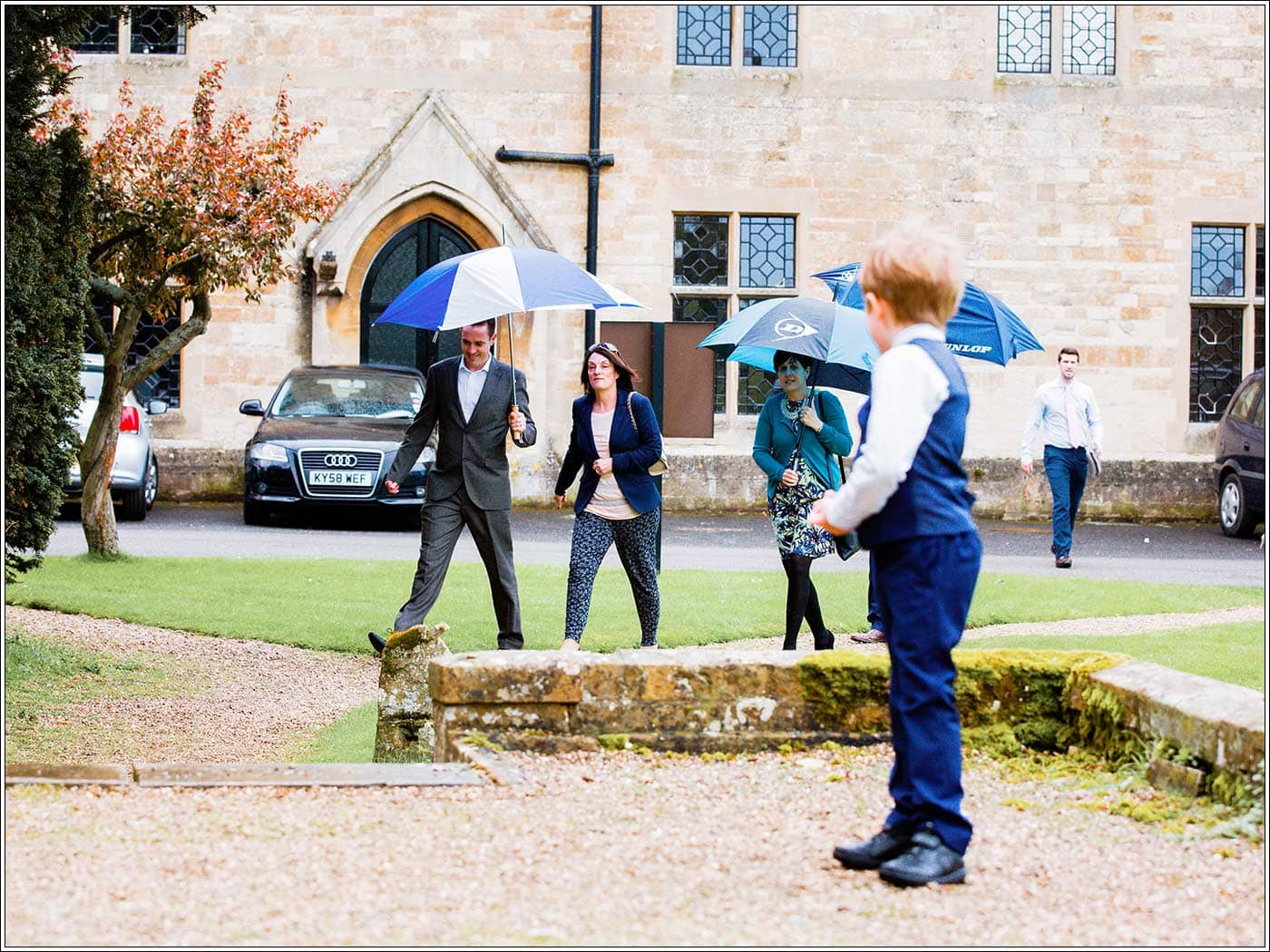 Guests arriving at St James D'Eivile church by Walton Hall