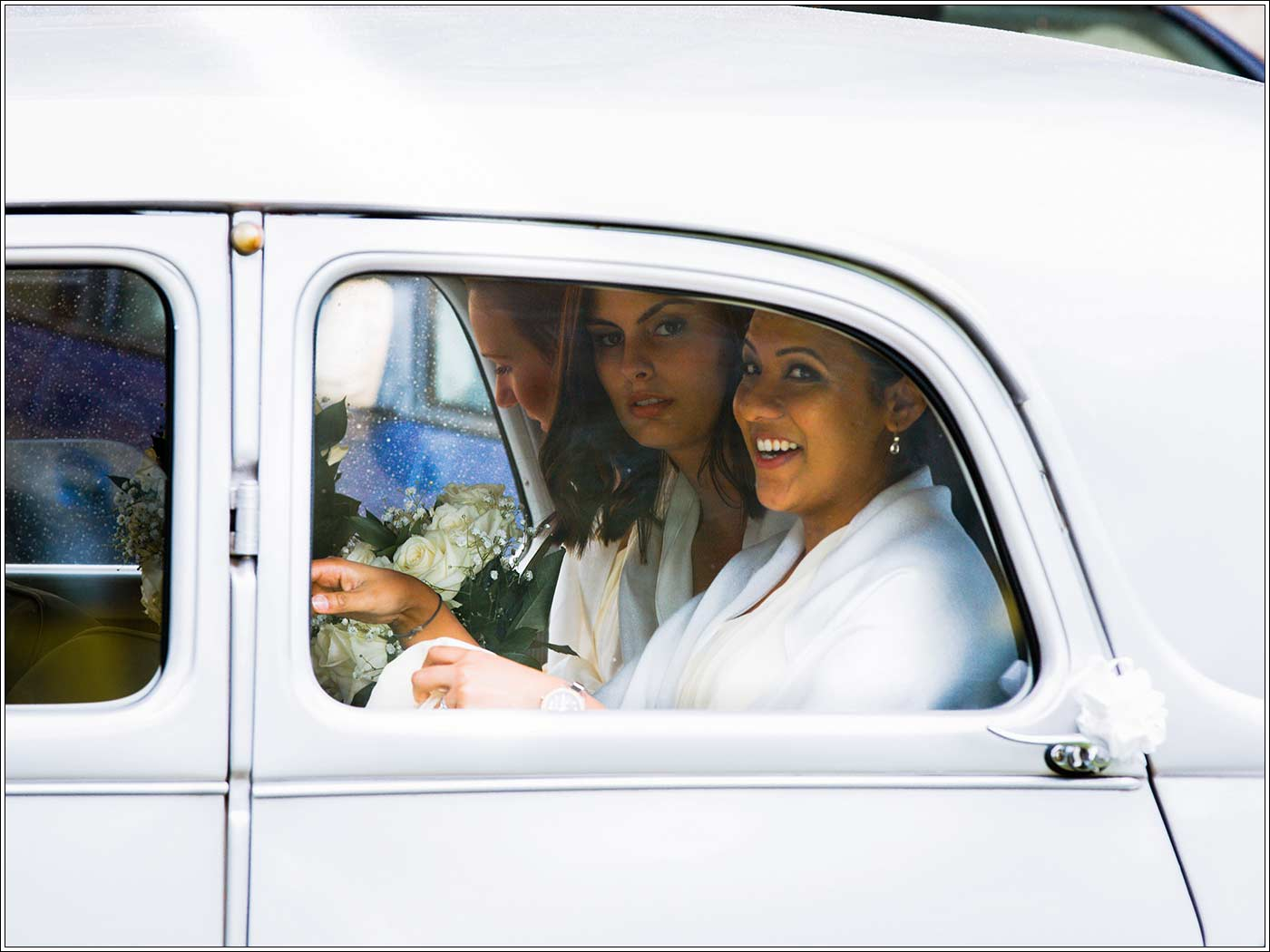 Bridemaids in wedding car