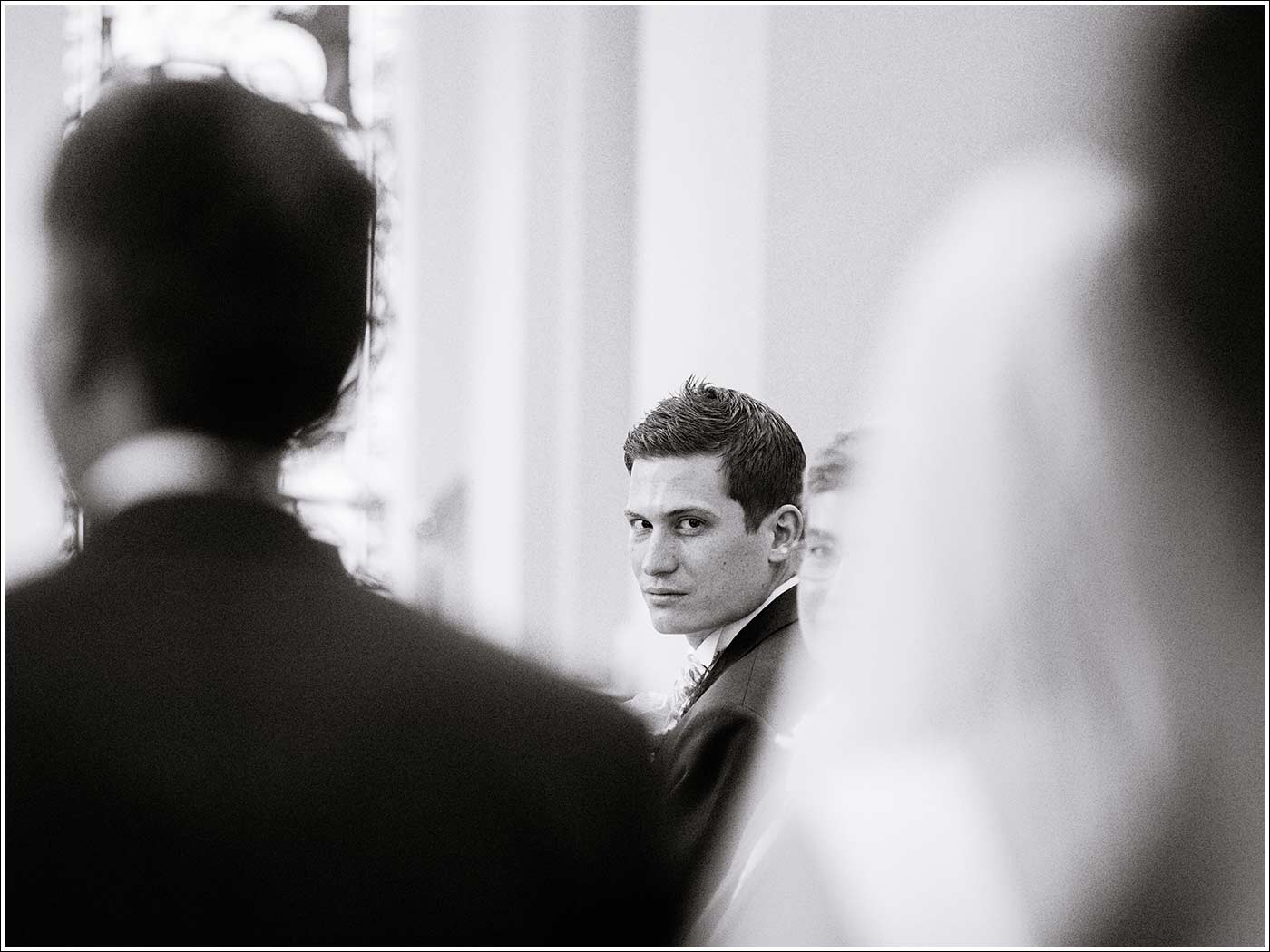 Groom seeing bride for first time at St James D'Eivile church by Walton Hall