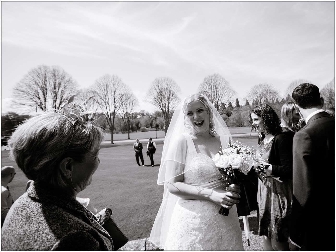 Happy bride after her Walton Hall wedding ceremony