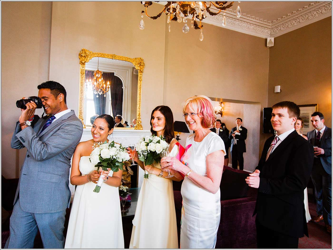 Guests welcoming bride and groom at Walton Hall