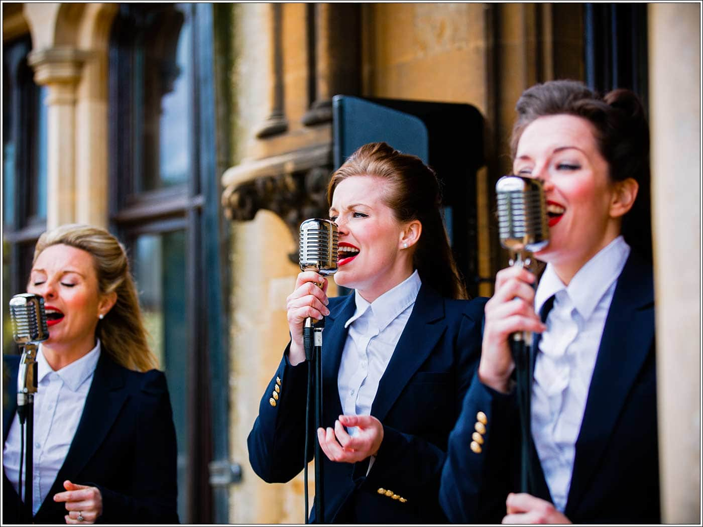 Bombshell Belles singing at Walton Hall