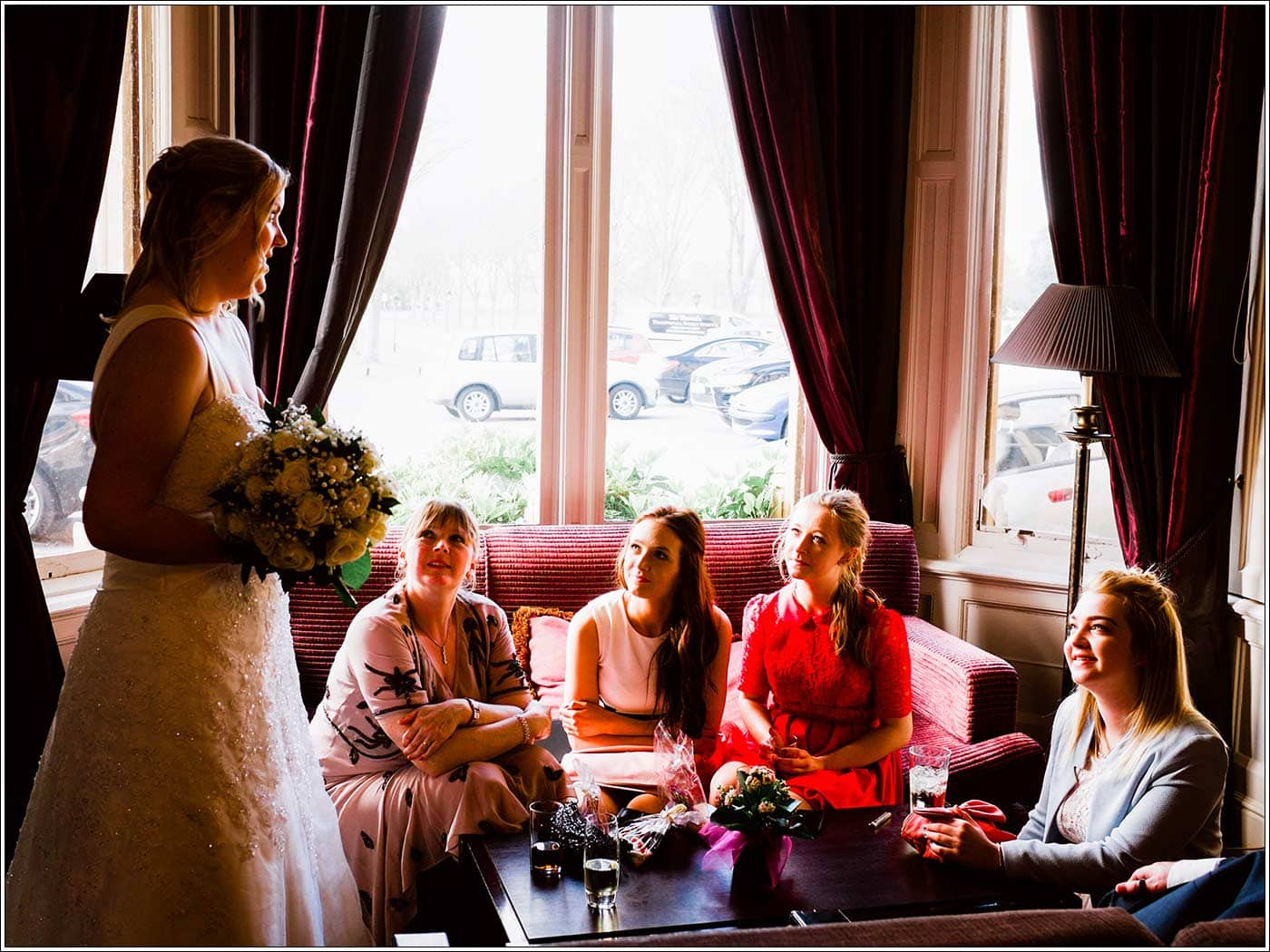 Bride talking to guests at Walton Hall wedding