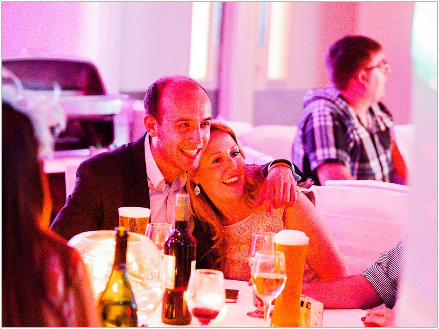 Happy guests during Walton Hall wedding evening reception