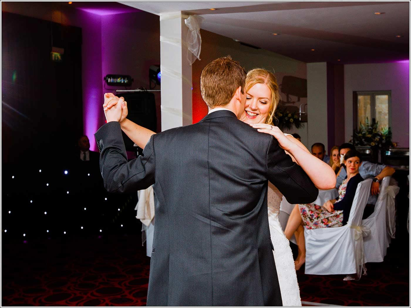 Smiling bride during first dance at Walton Hall