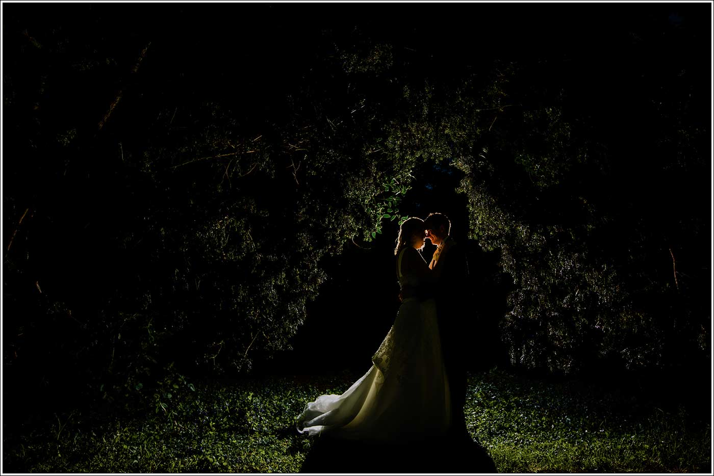 Silhouette of bride and groom at their Walton Hall wedding
