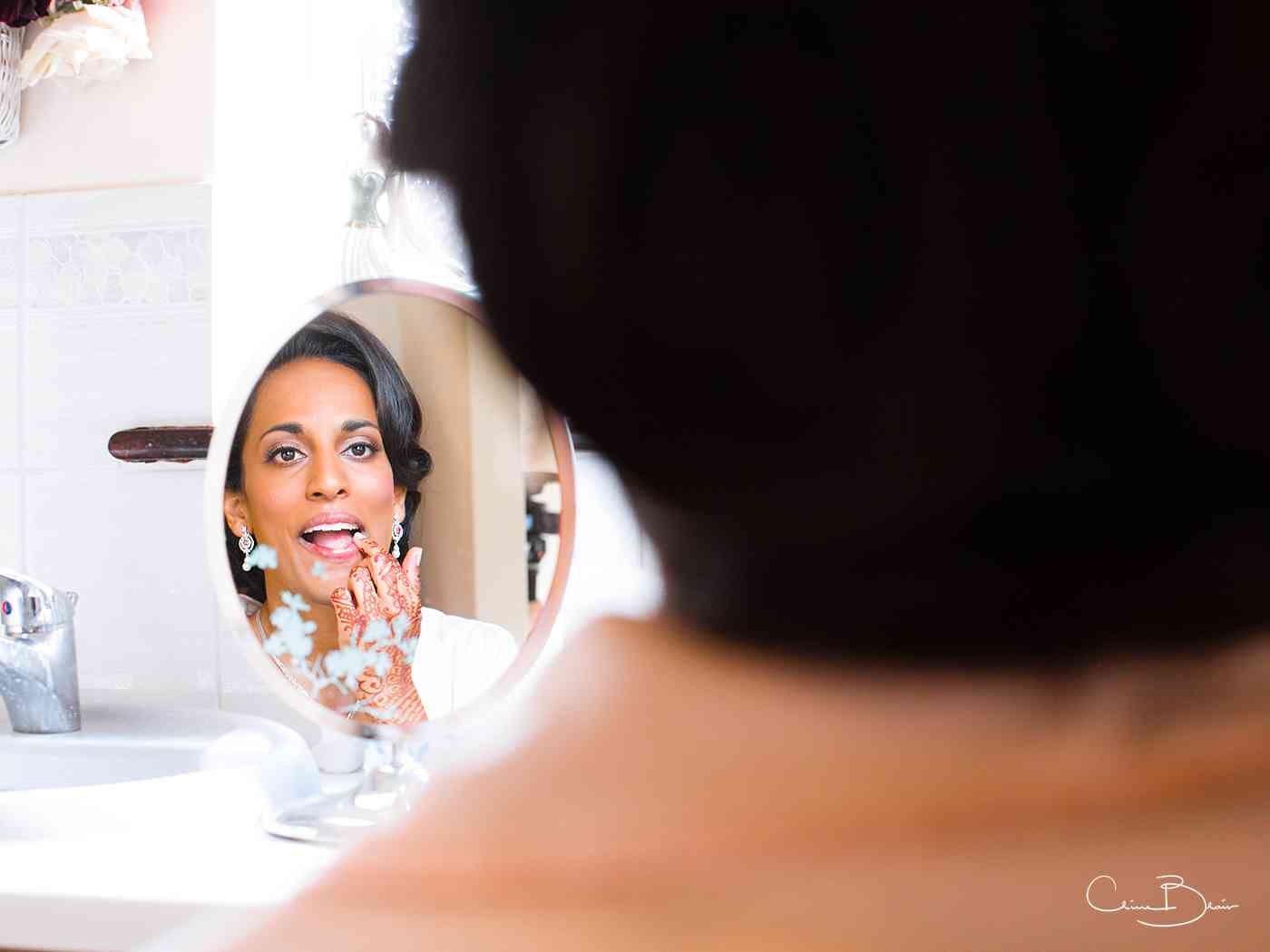 Bride getting ready by Ragley Hall documentary wedding photographer Clive Blair