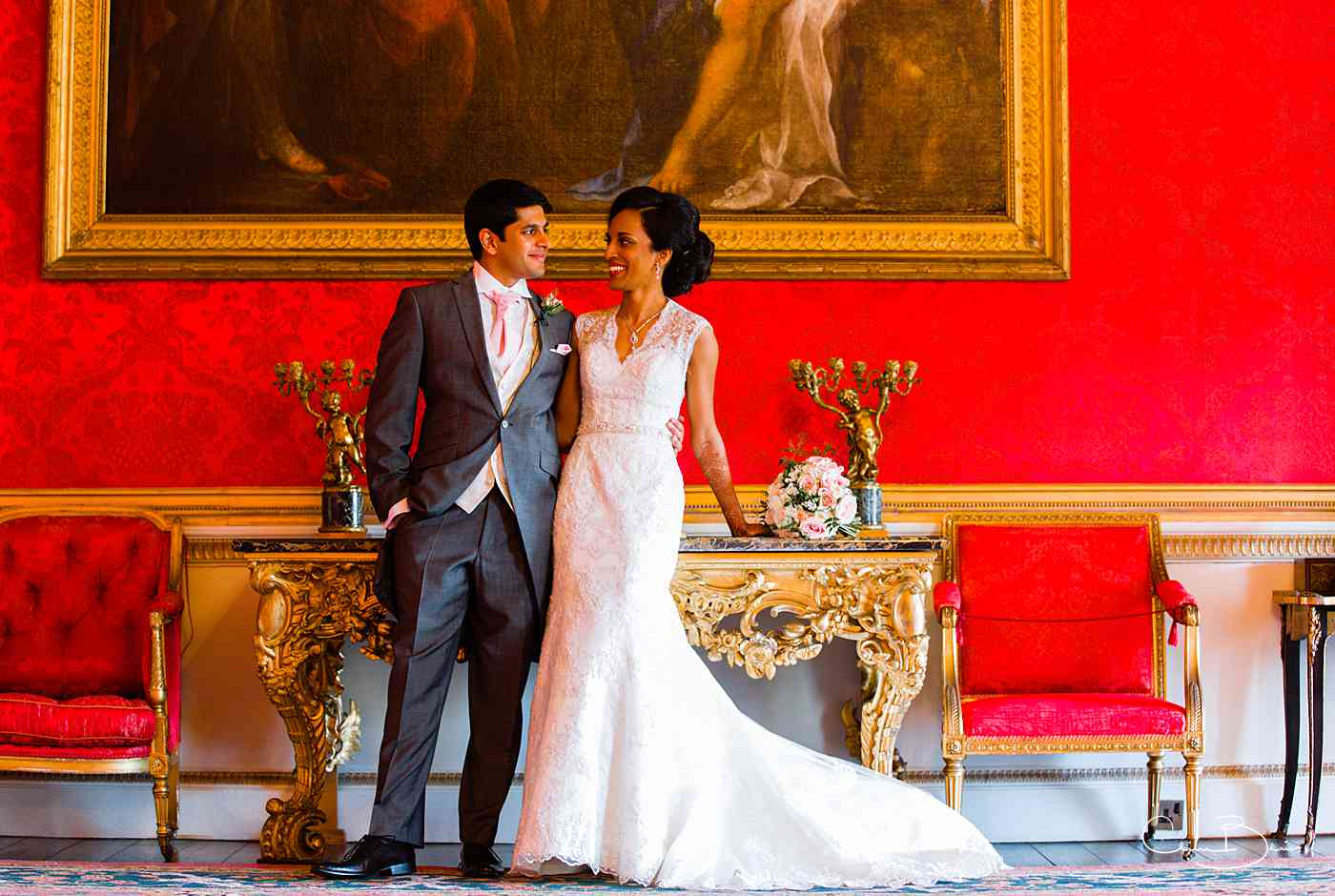 Bride and groom in Red room of Ragley Hall