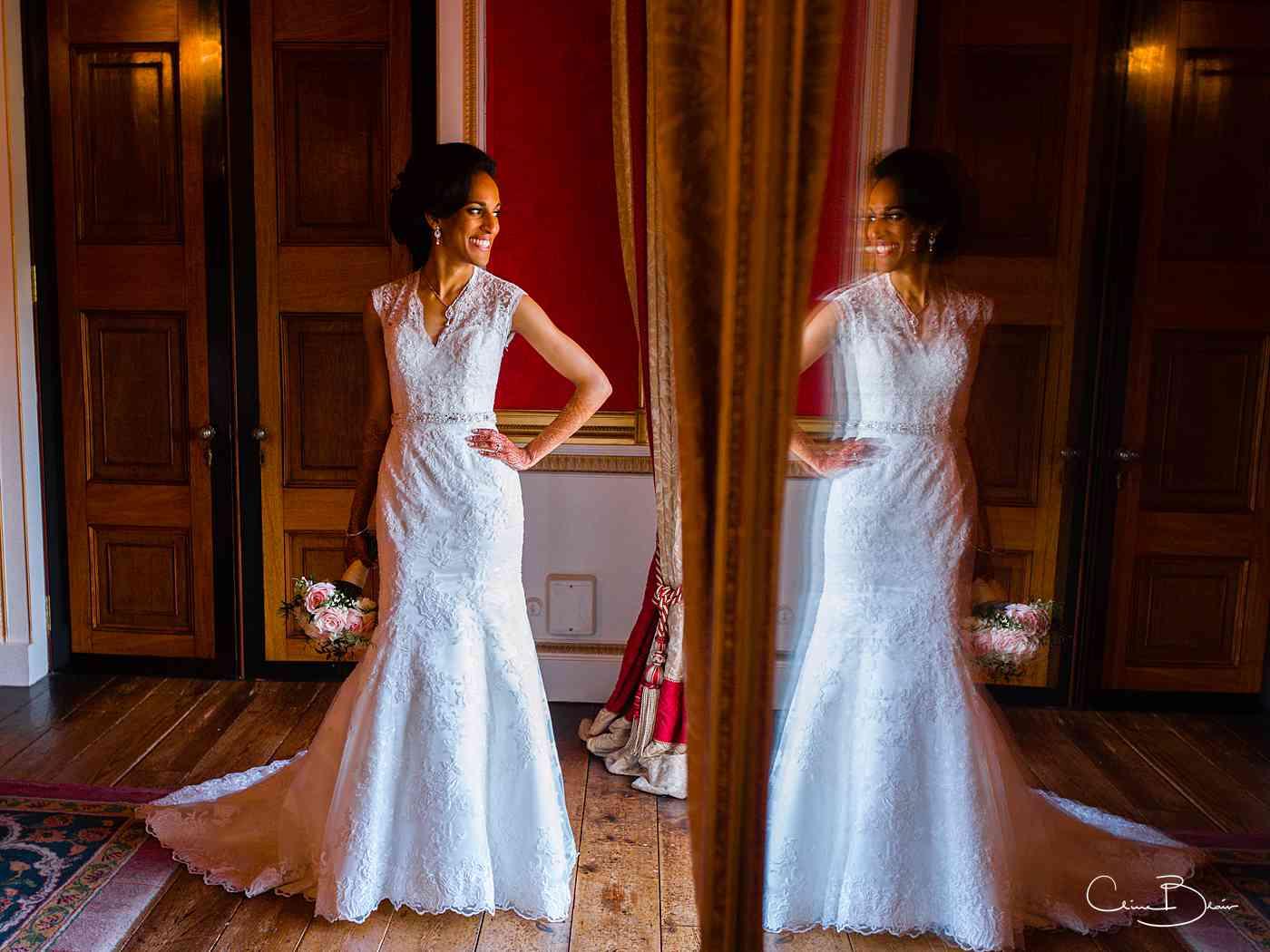 Bride in reflexction of mirror at Ragley Hall