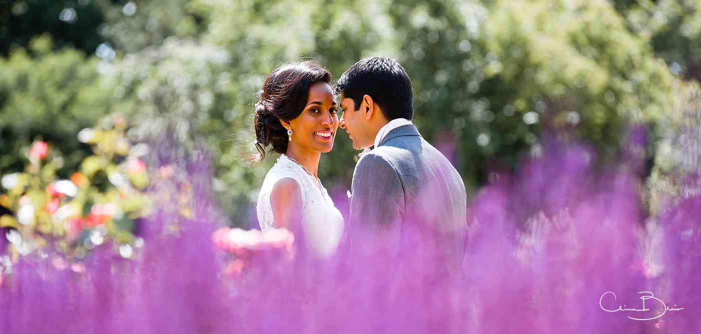 Indian bride and groom in garden of Ragley Hall
