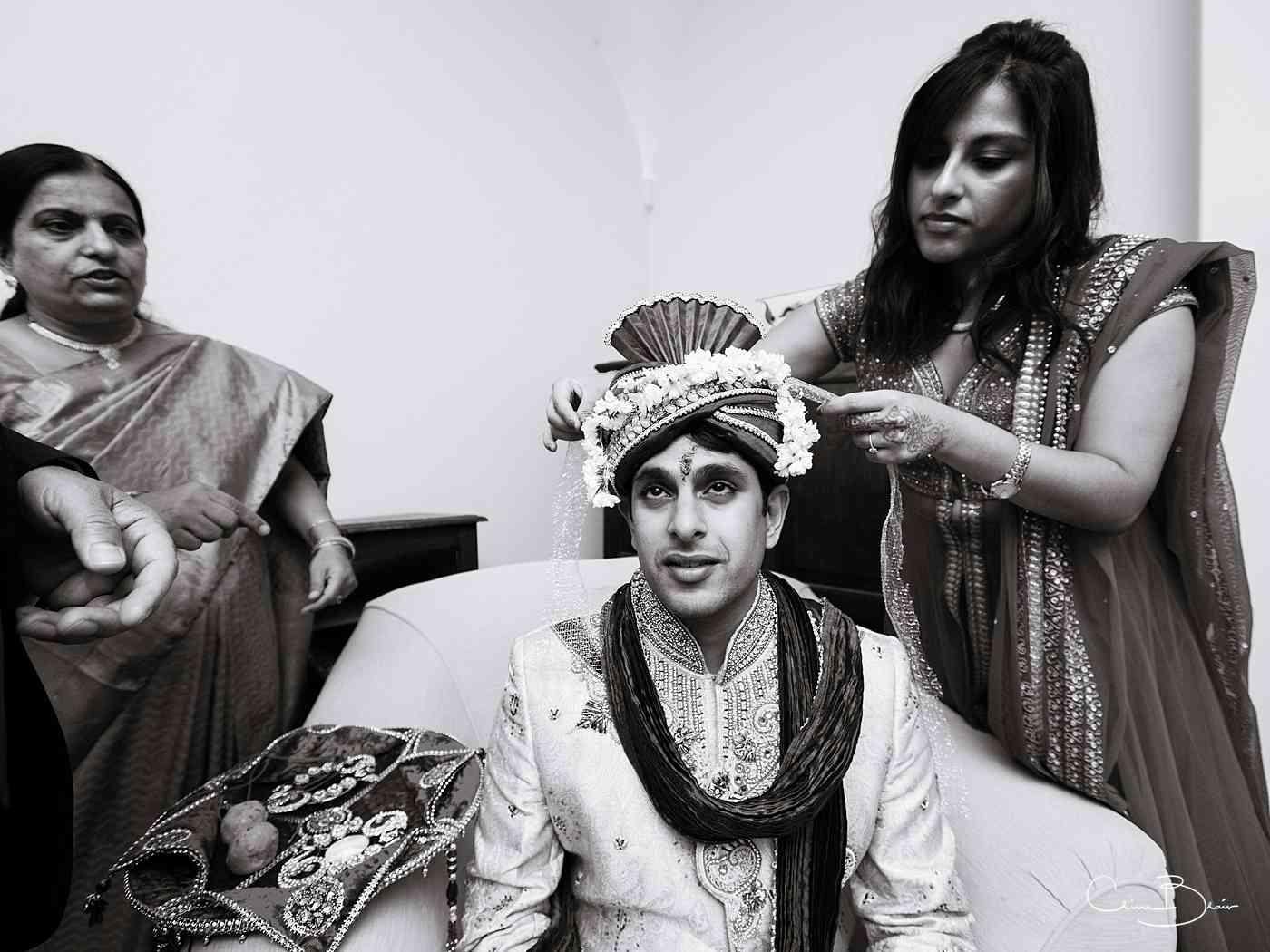 Groom having his turban put on before his weddingceremony