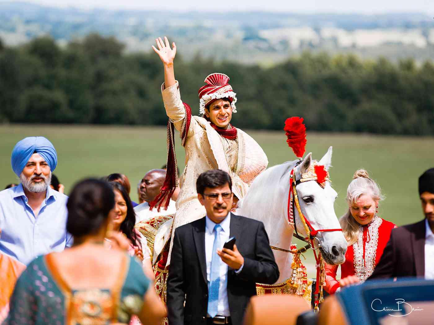 Indian groom on horseback