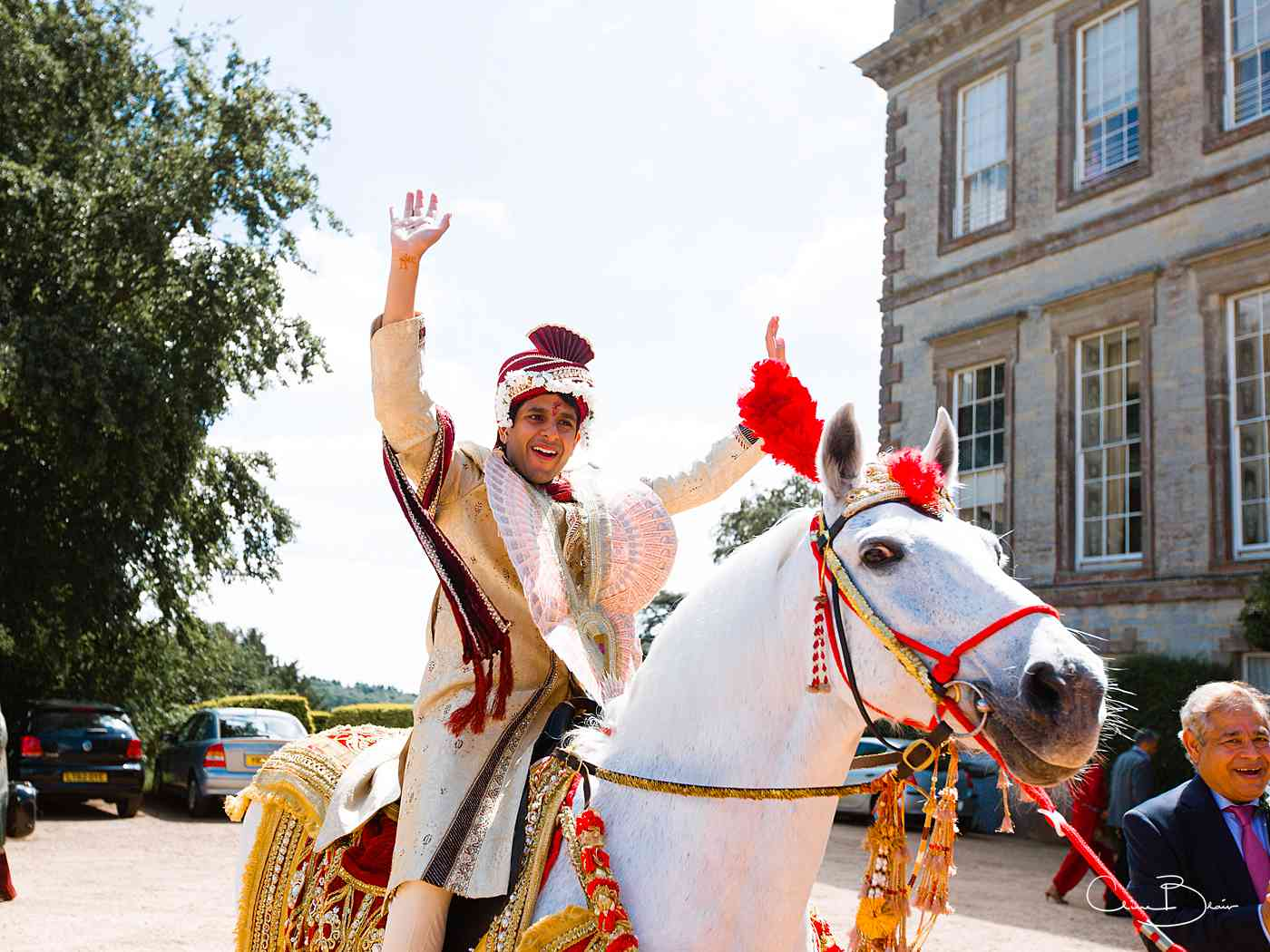 Indian groom on horseback arring for his Hindu wedding at Ragley Hall