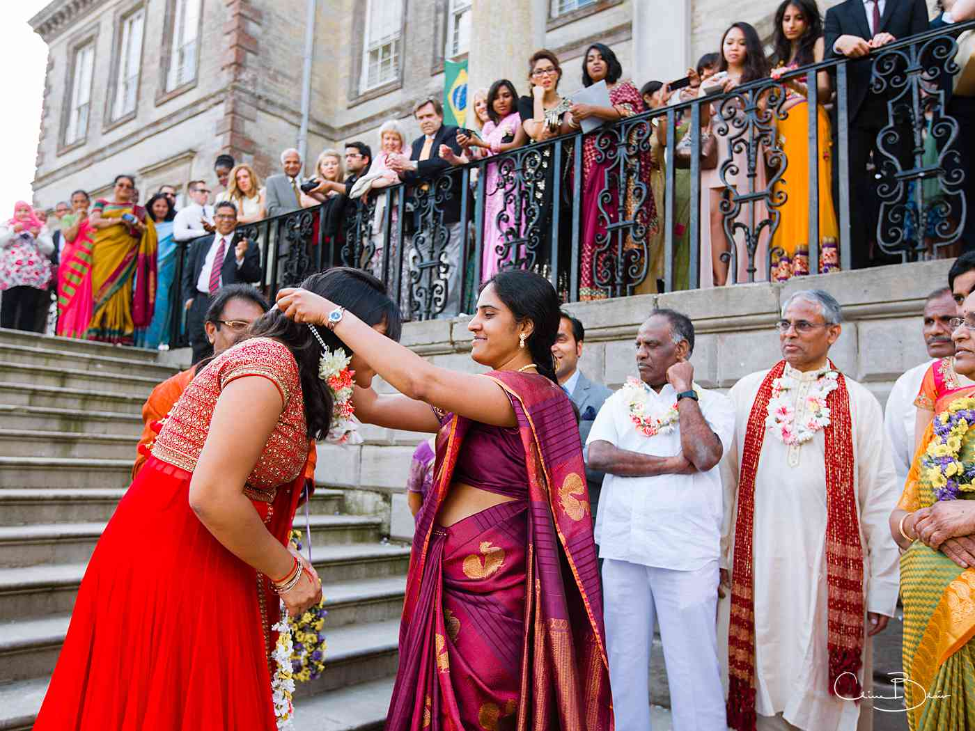 Indian guest receving wedding garland before wedding ceremony