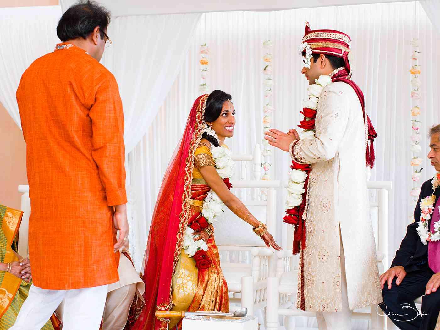 Bride welcoming groom during Hindu wedding celebration