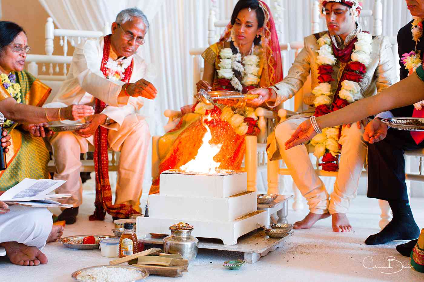 Fire being stoked during Indian wedding ceremony