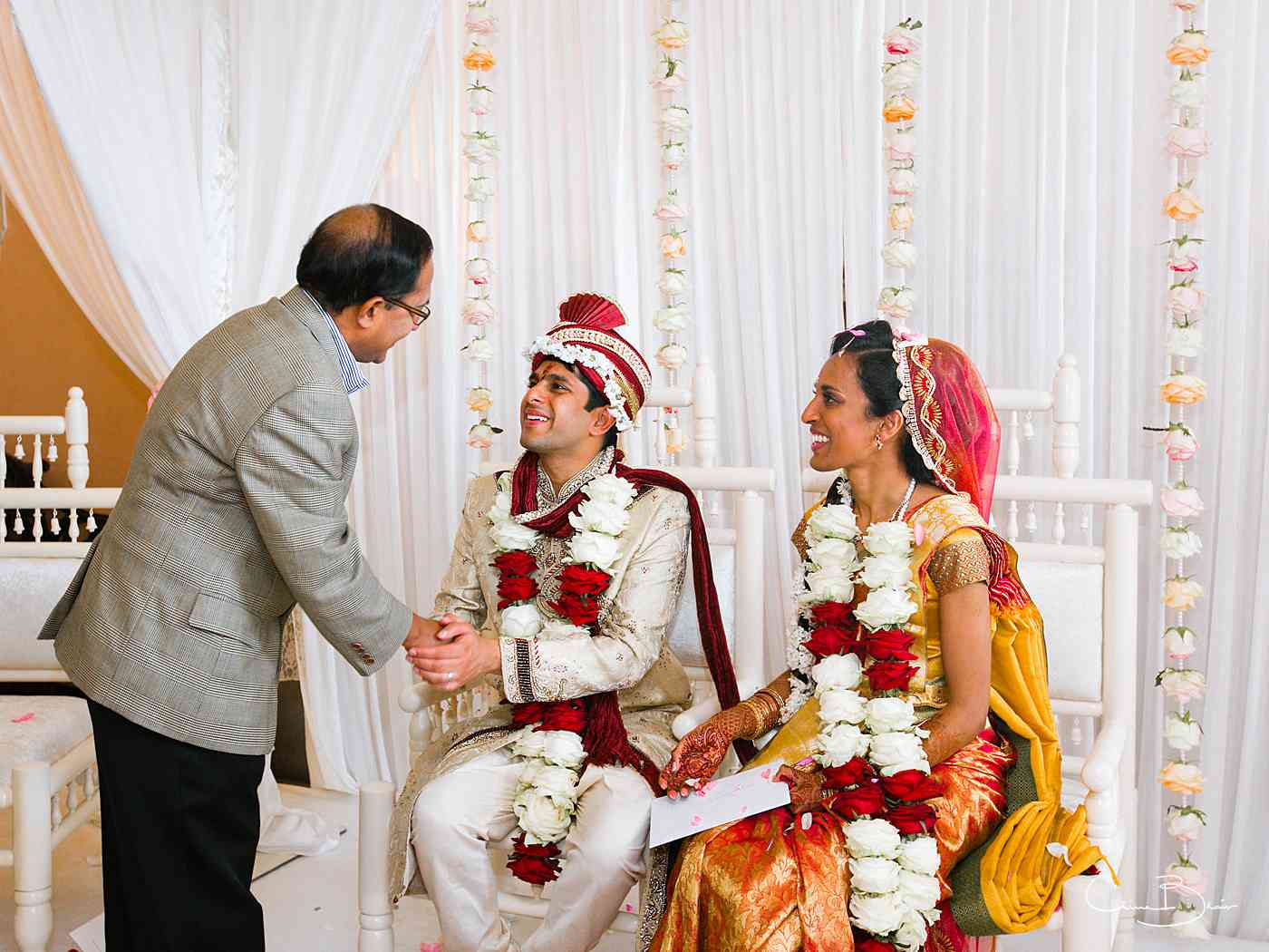 Groom being greeted by wedding guest