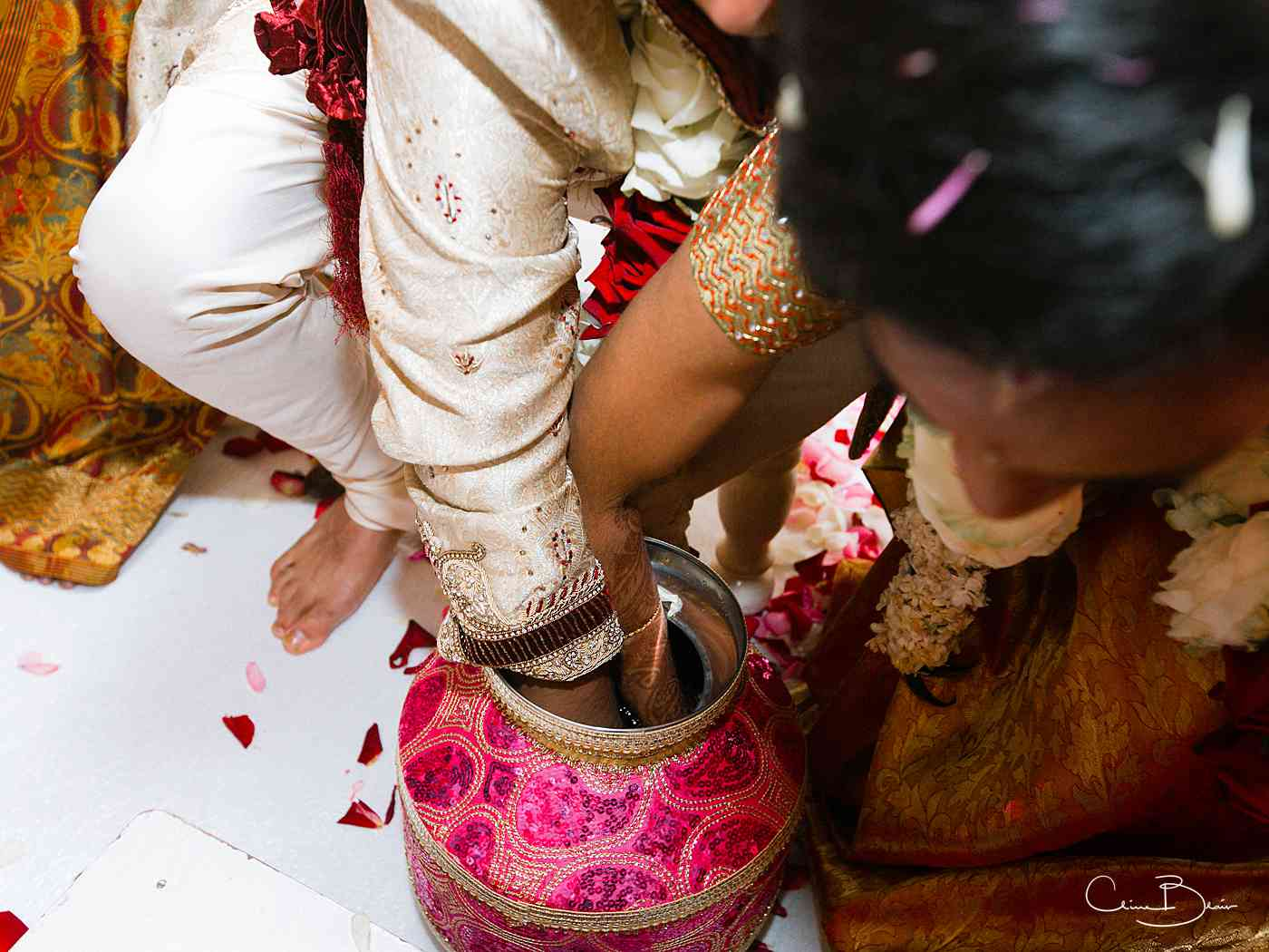 Bride and groom playing games during their Indian wedding ceremony