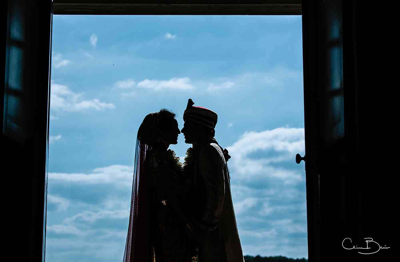Indian bride and groom in silhouette