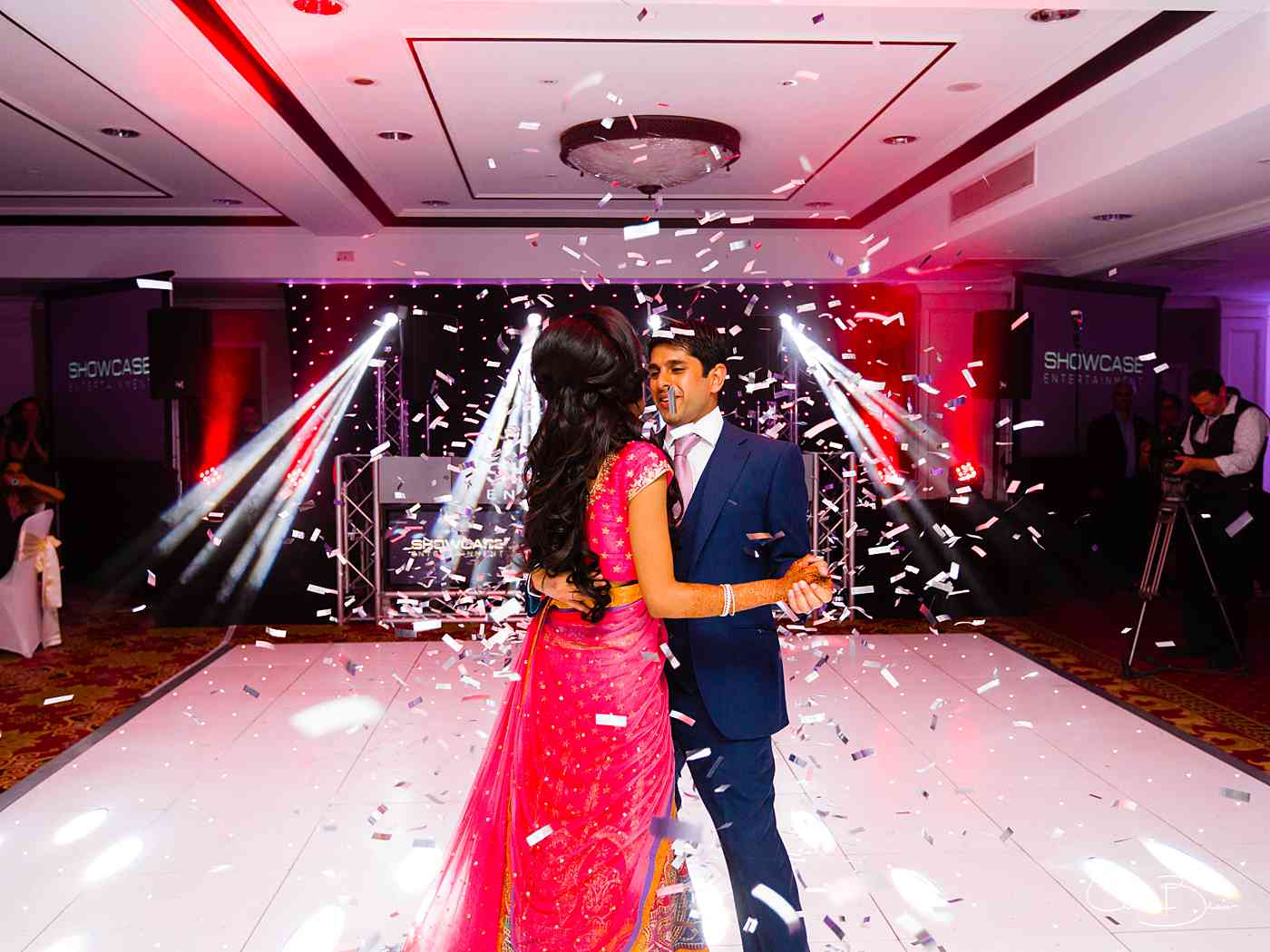 Bride and groom being showered with a confetti bomb during their first dance