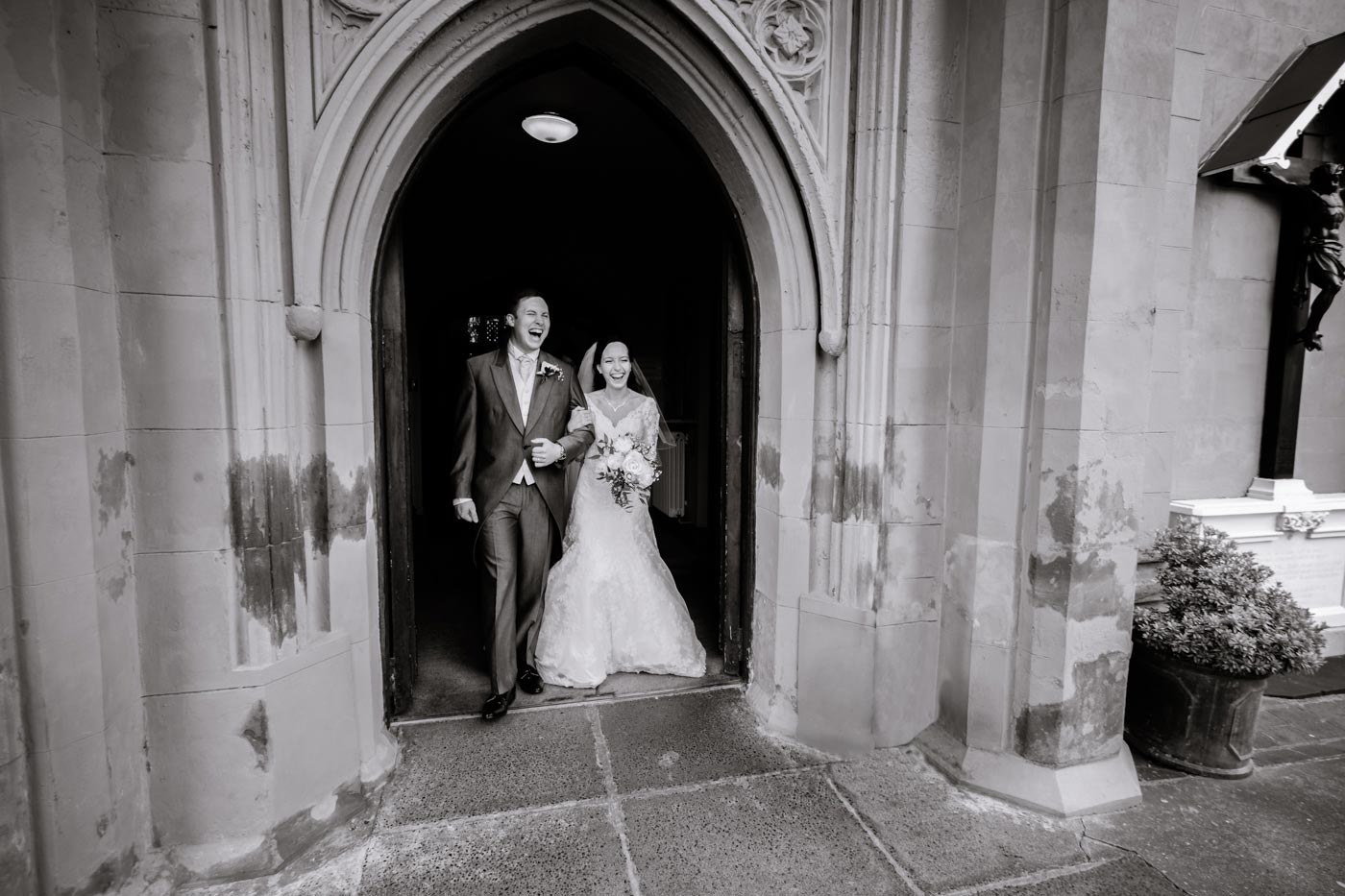 Bride and groom laughing as they exit their wedding ceremony