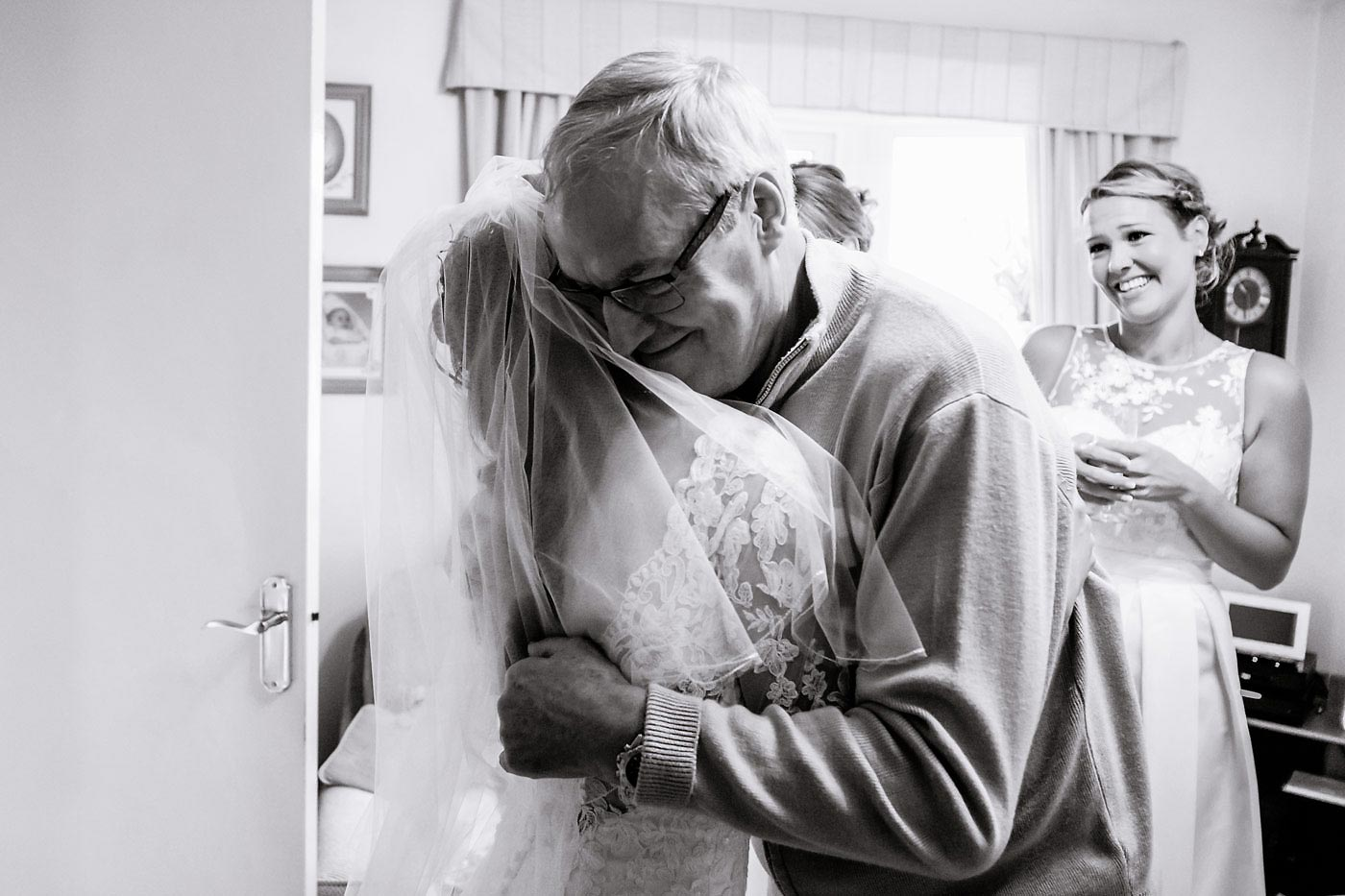 Father hugging his daughter bride