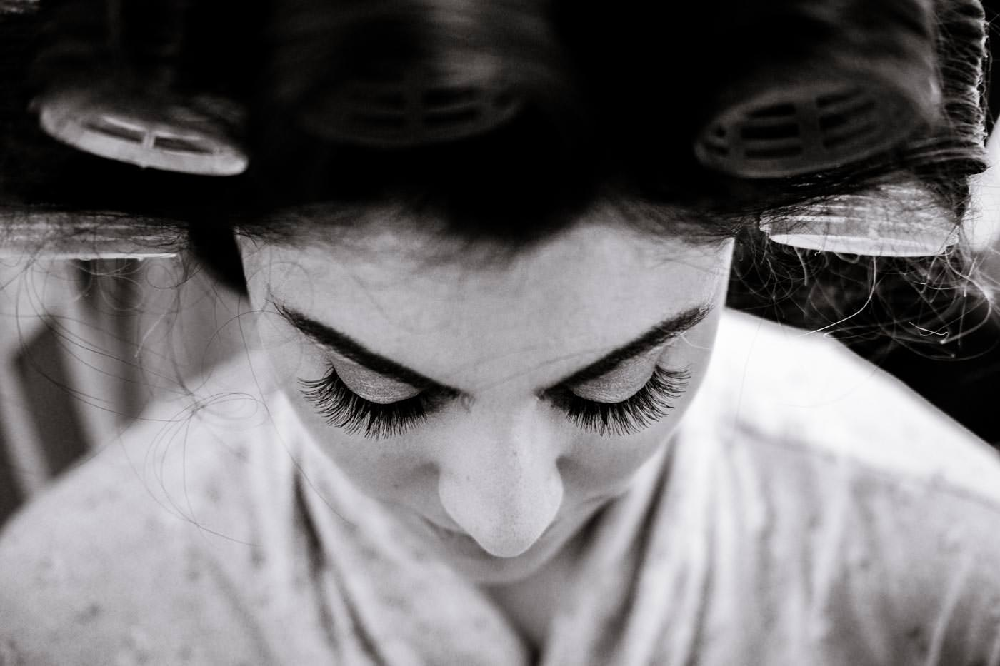 Bride having her eyelashes done