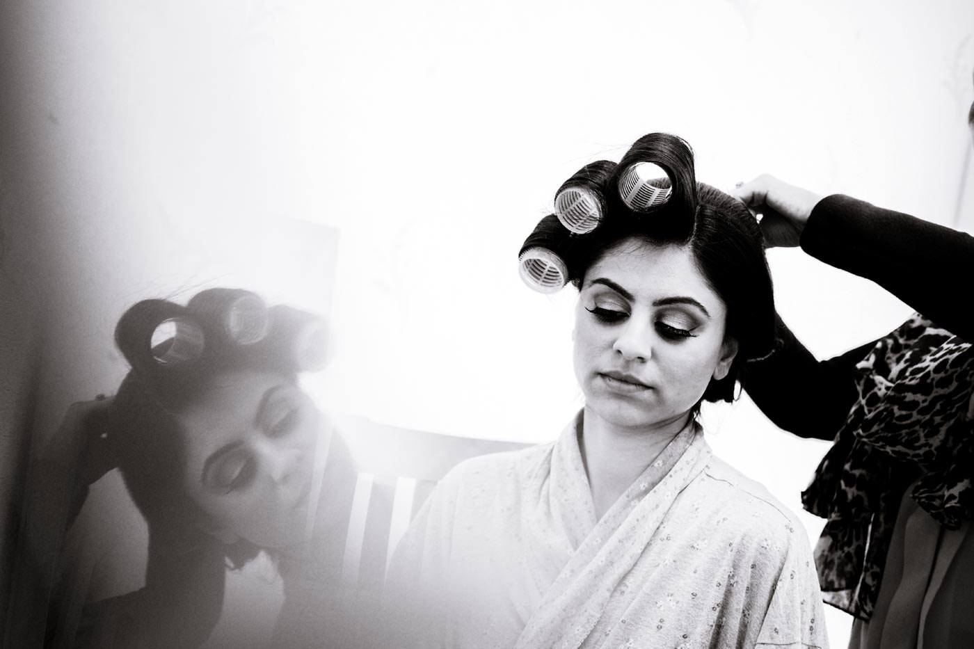 Indian bride having her hair done