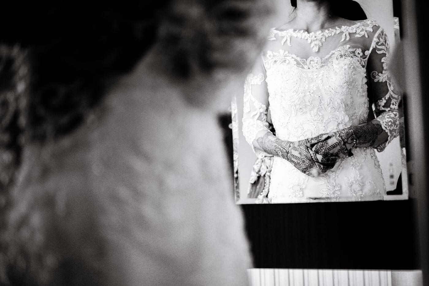 Indian bride's hands refelcted in mirror showing her mehndi
