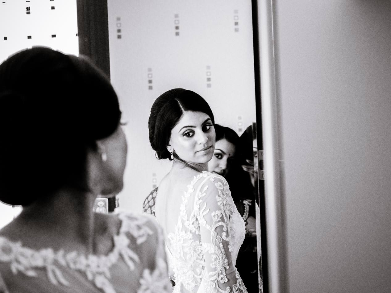 Indian bride looking at her self in the mirror