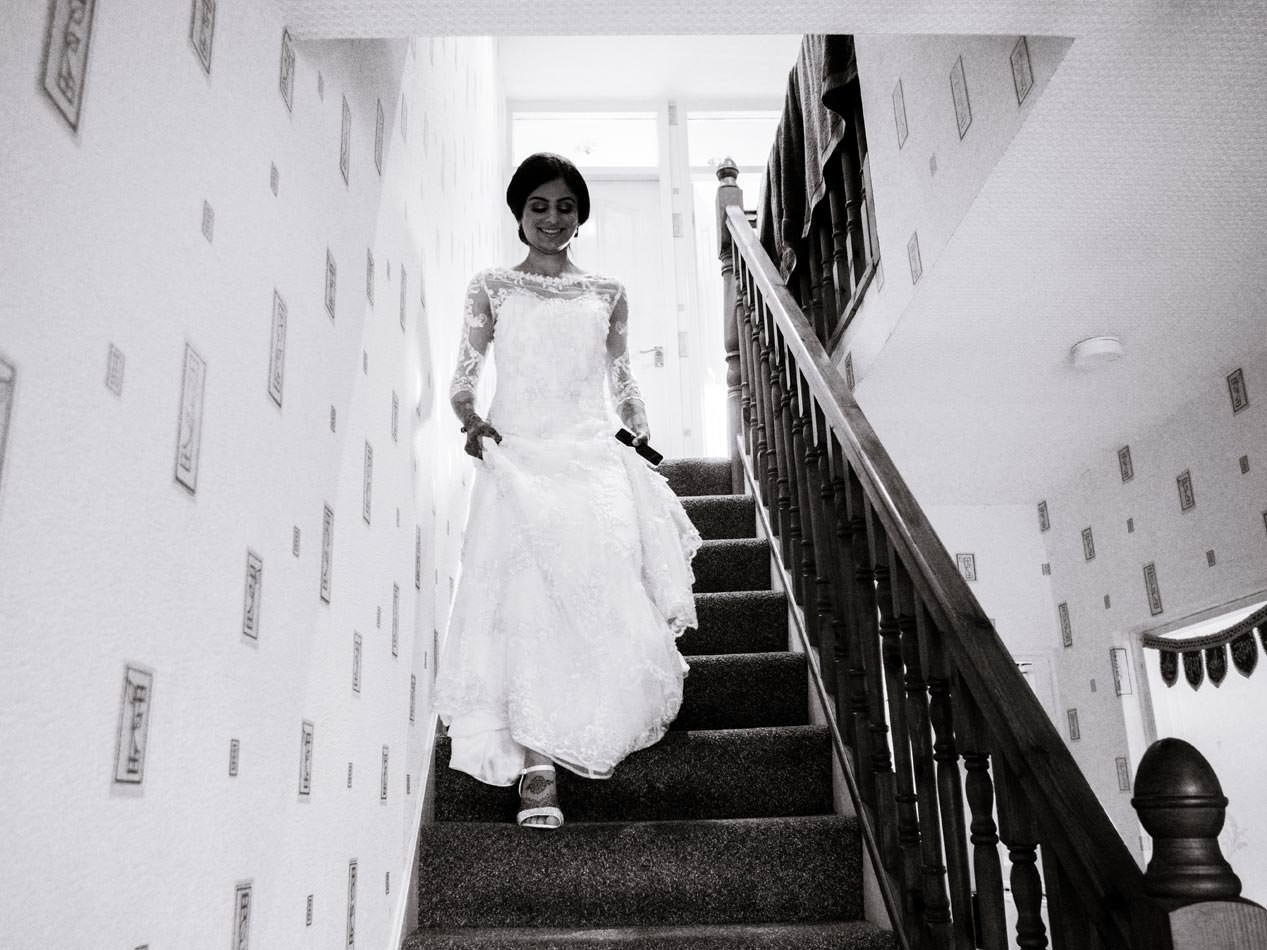 Indian bride walking down the stairs on the way to her wedding