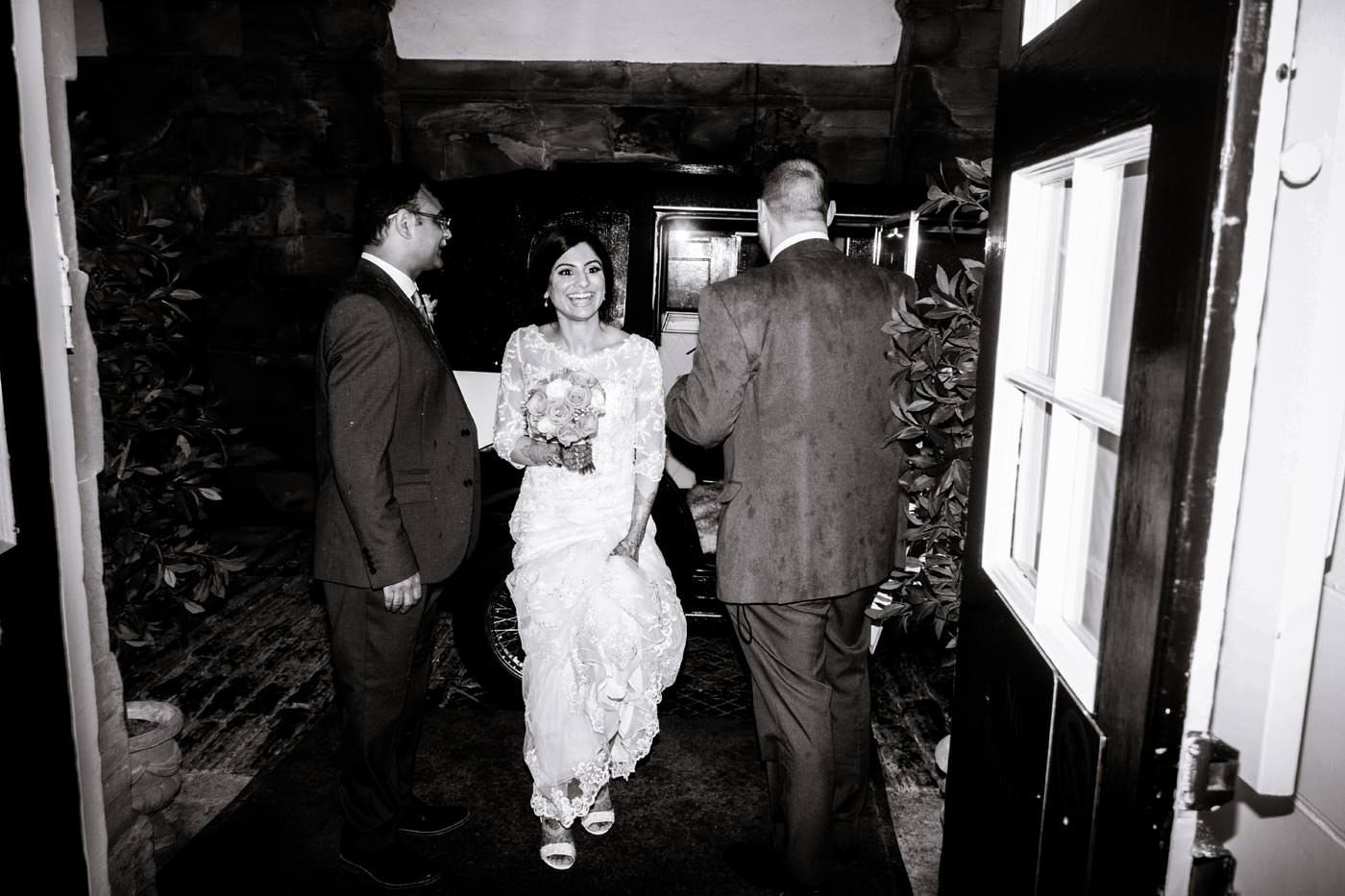 Indian bride walking into Ragley Hall