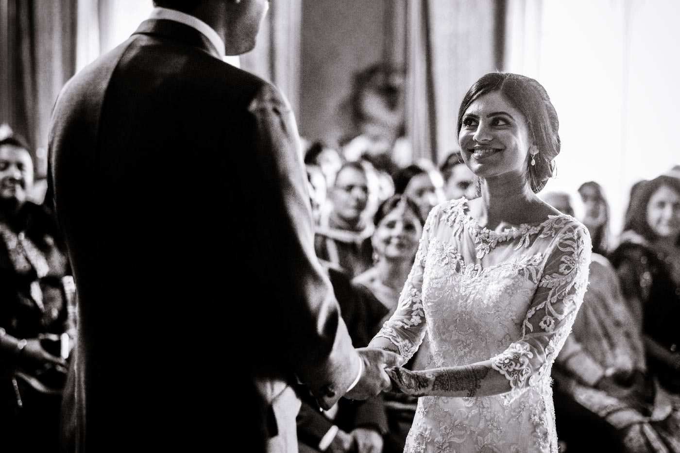 Happy Indian bride during the ceremony at Ragley Hall