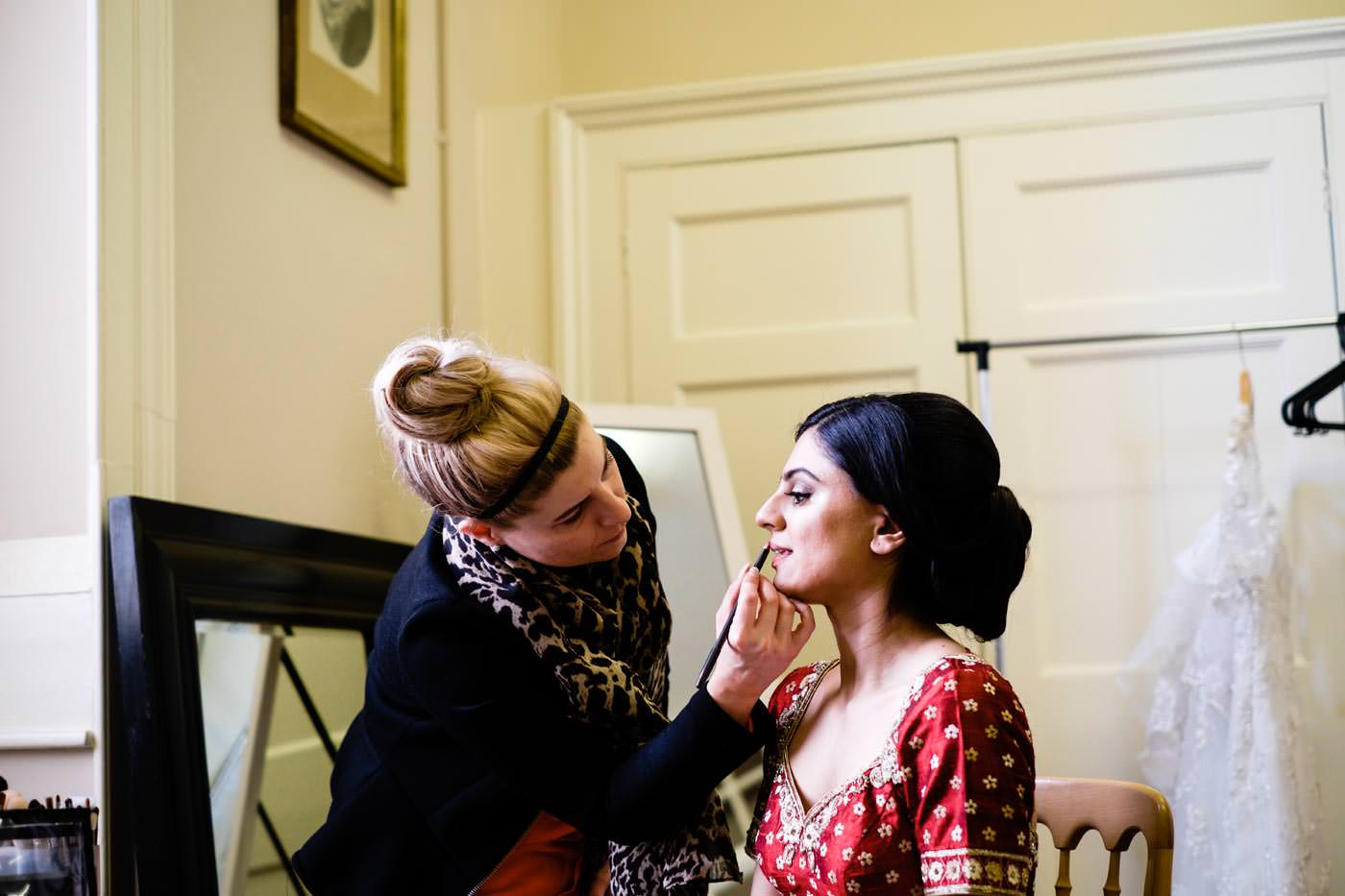 Bride getting ready at Ragley Hall before for her Hindu wedding ceremony