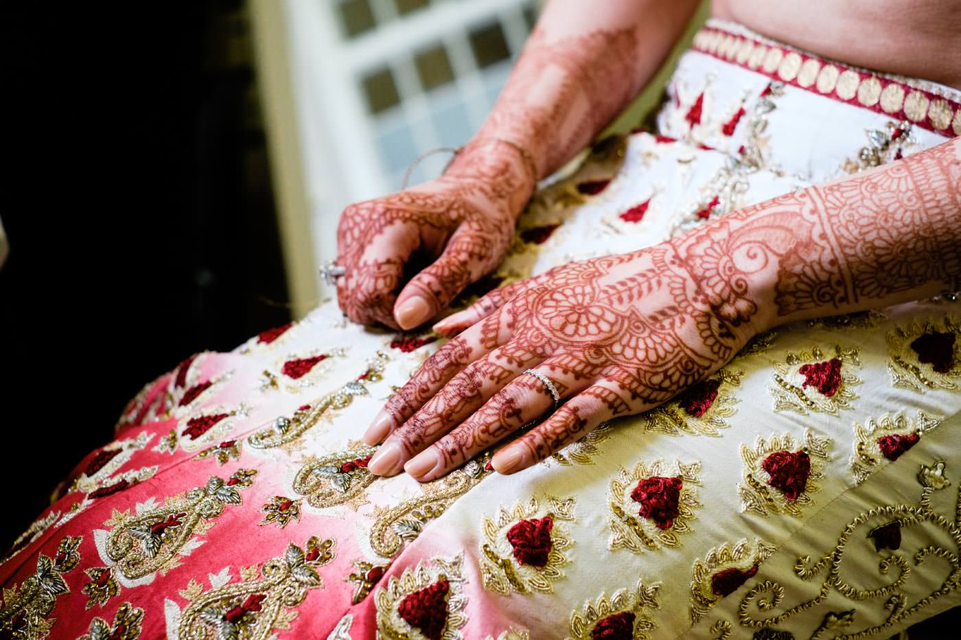 Close-up of mehndi as Bride getting ready at Ragley Hall before for her Hindu wedding ceremony