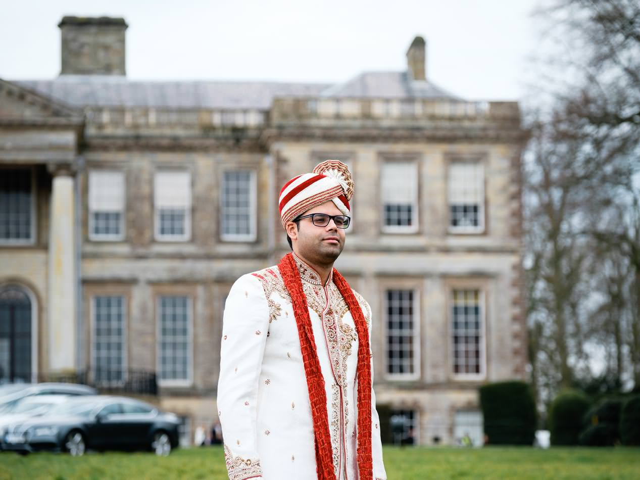 Proud groom at Ragley Hall before for his Hindu wedding ceremony