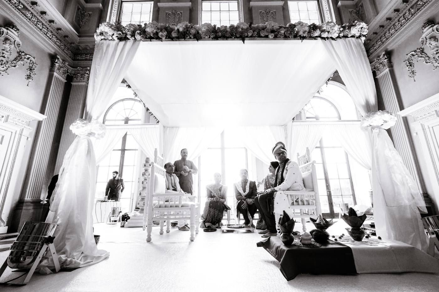 groom sitting on the mendap waiting for his bride's arrival at Ragley Hall