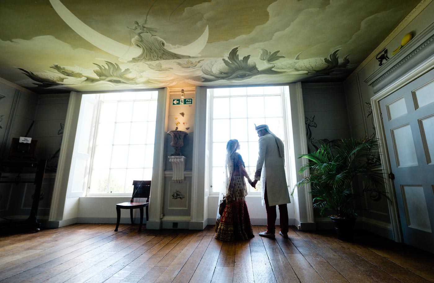 Bride and groom in silhouette at Ragley Hall