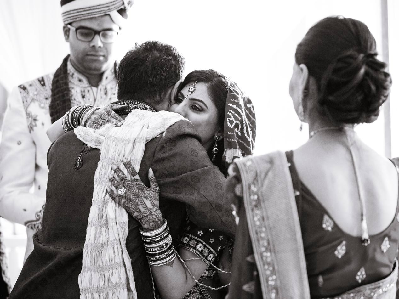 Tearful bride saying goodbye to her father