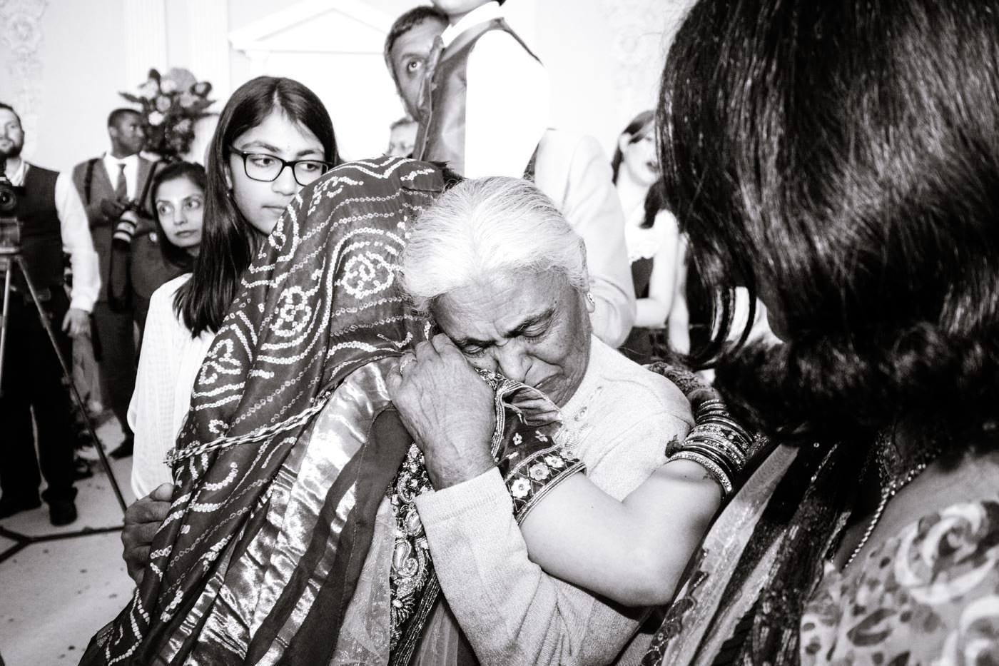 Tearful bride saying goodbye to her elderly relative