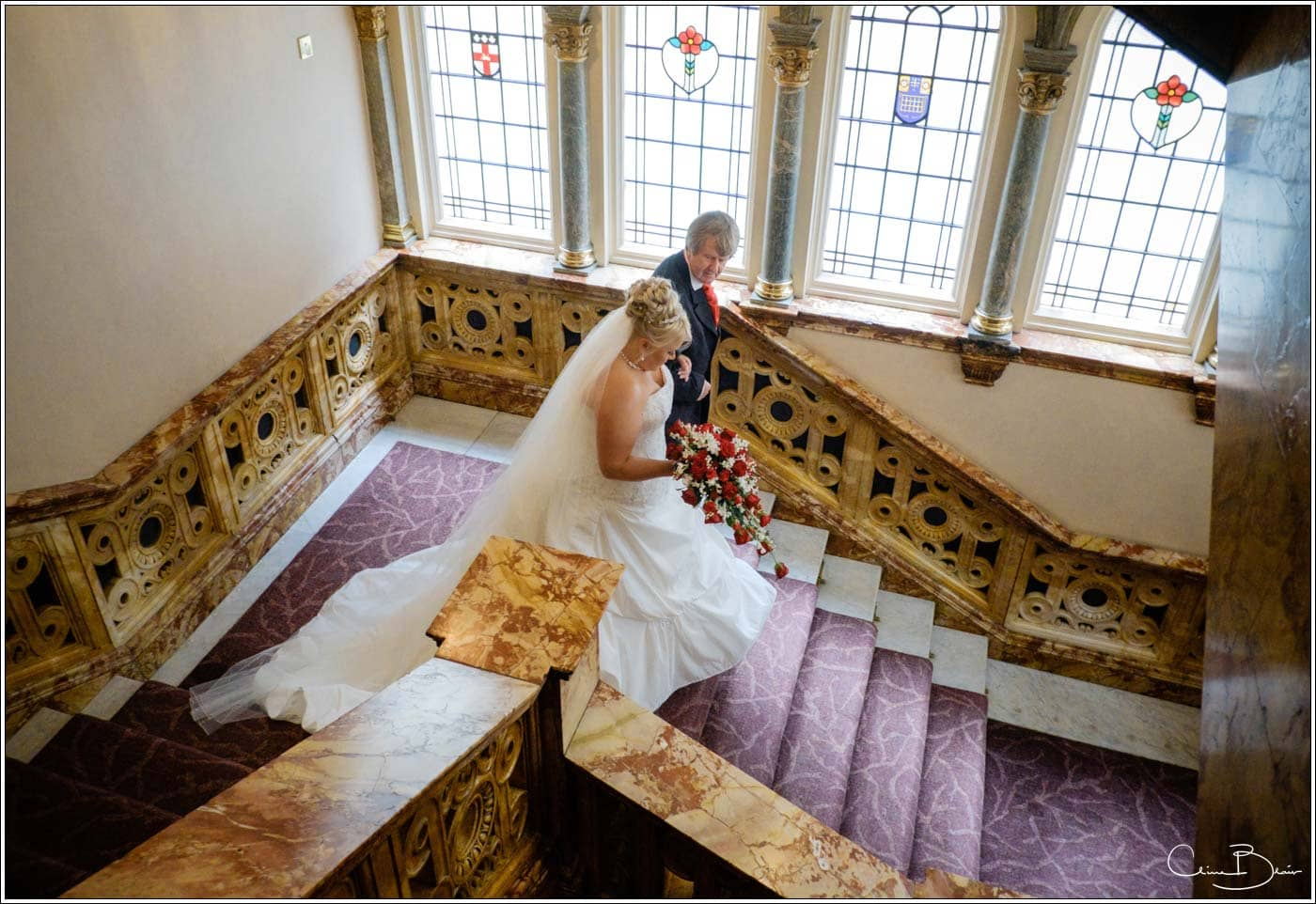 Bride and father descending Hotel Russell's stairs on the way to her Botley's mansion wedding