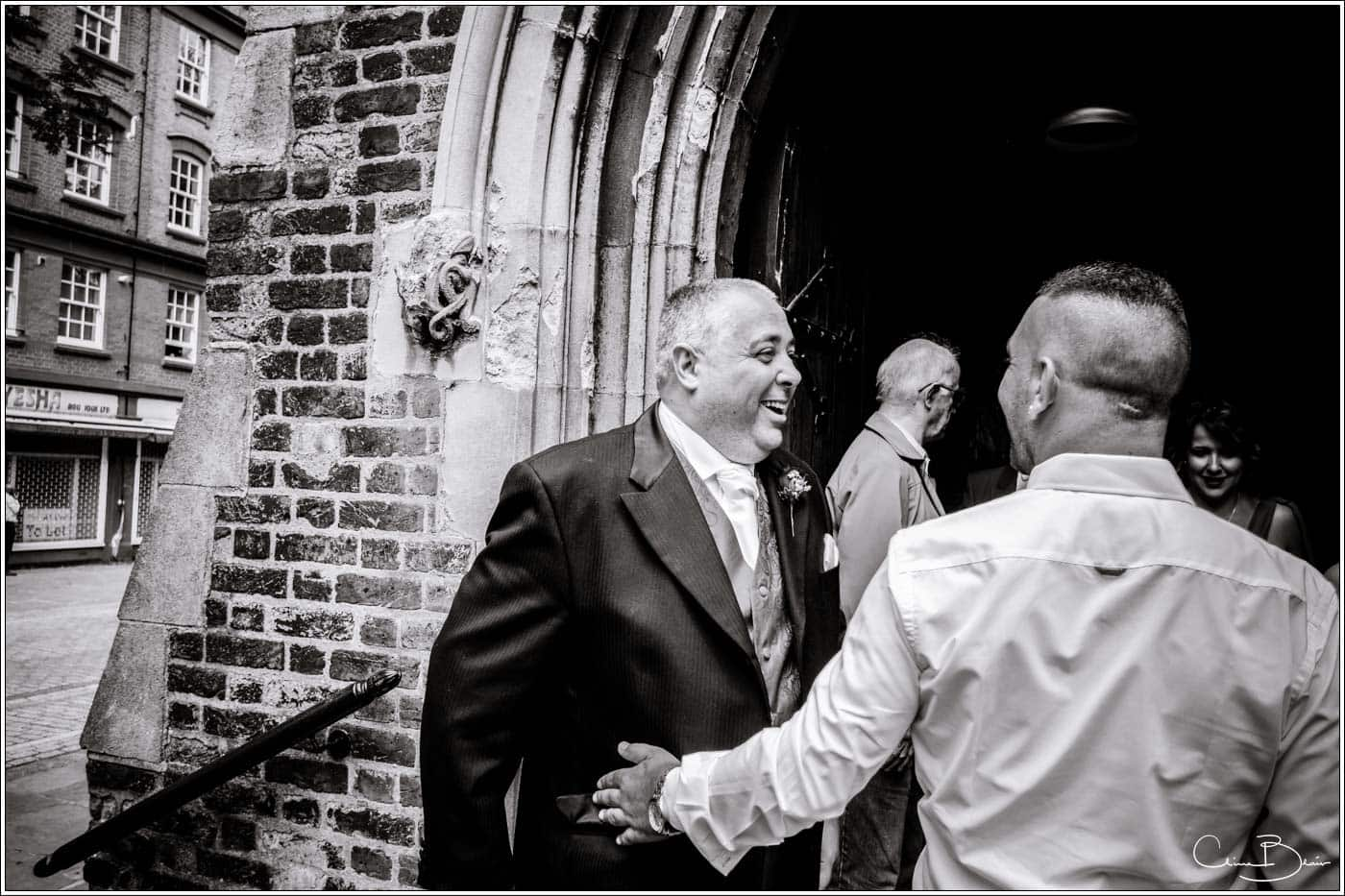 groom at church before his botleys mansion wedding reception