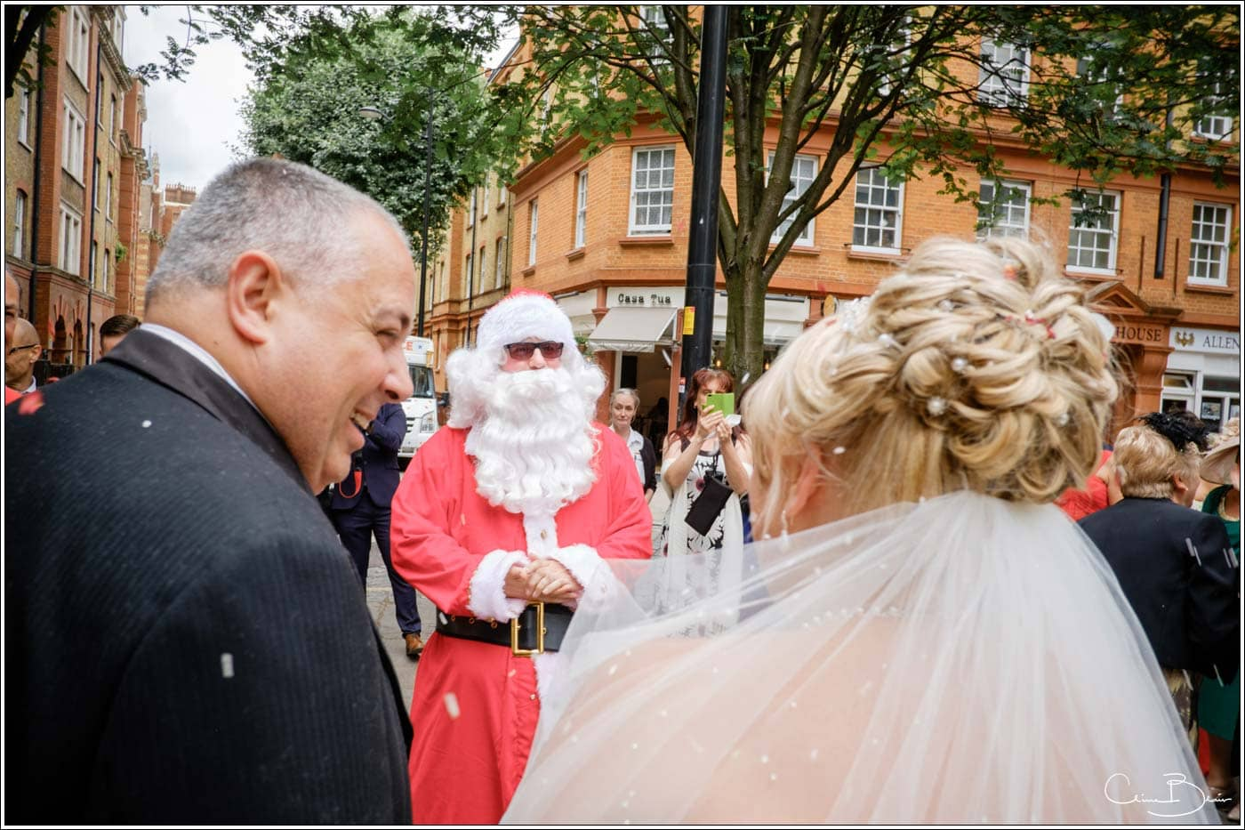 Bride seeing Father Christmas during a summer wedding in London