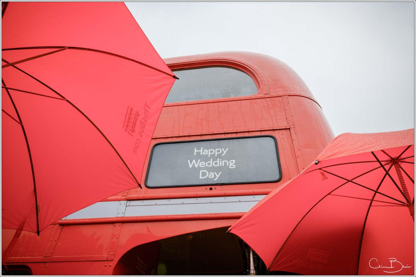 red double decker bus at a botleys mansion wedding reception
