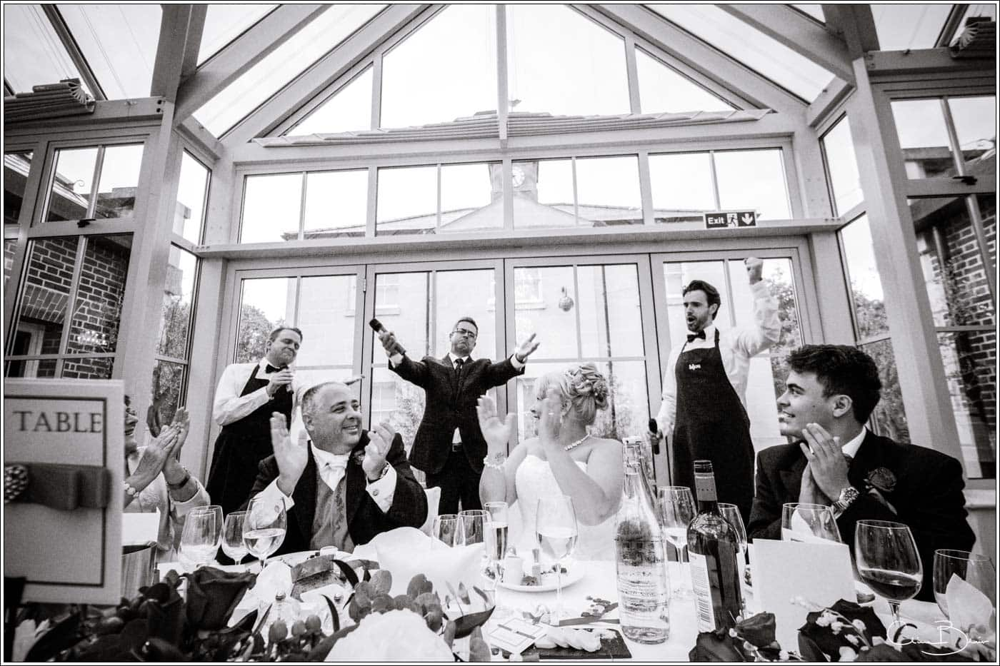 singing waiters with bride and groom at a botleys mansion wedding reception