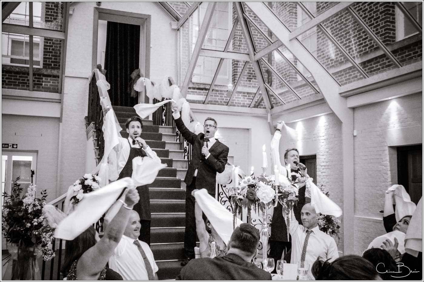singing waiters waving their napkins at a botleys mansion wedding reception