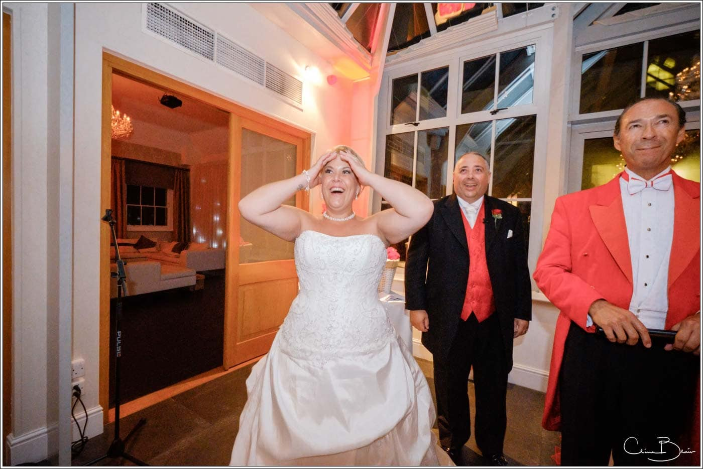 Shocked bride seeing Father Christmas in the summer at her Botleys Mansion
