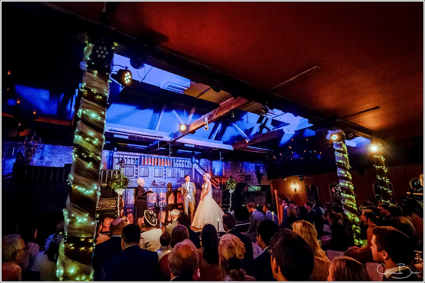 Coombe Abbey wedding photography showing the ambience of a wedding ceremony in the Abbeygate