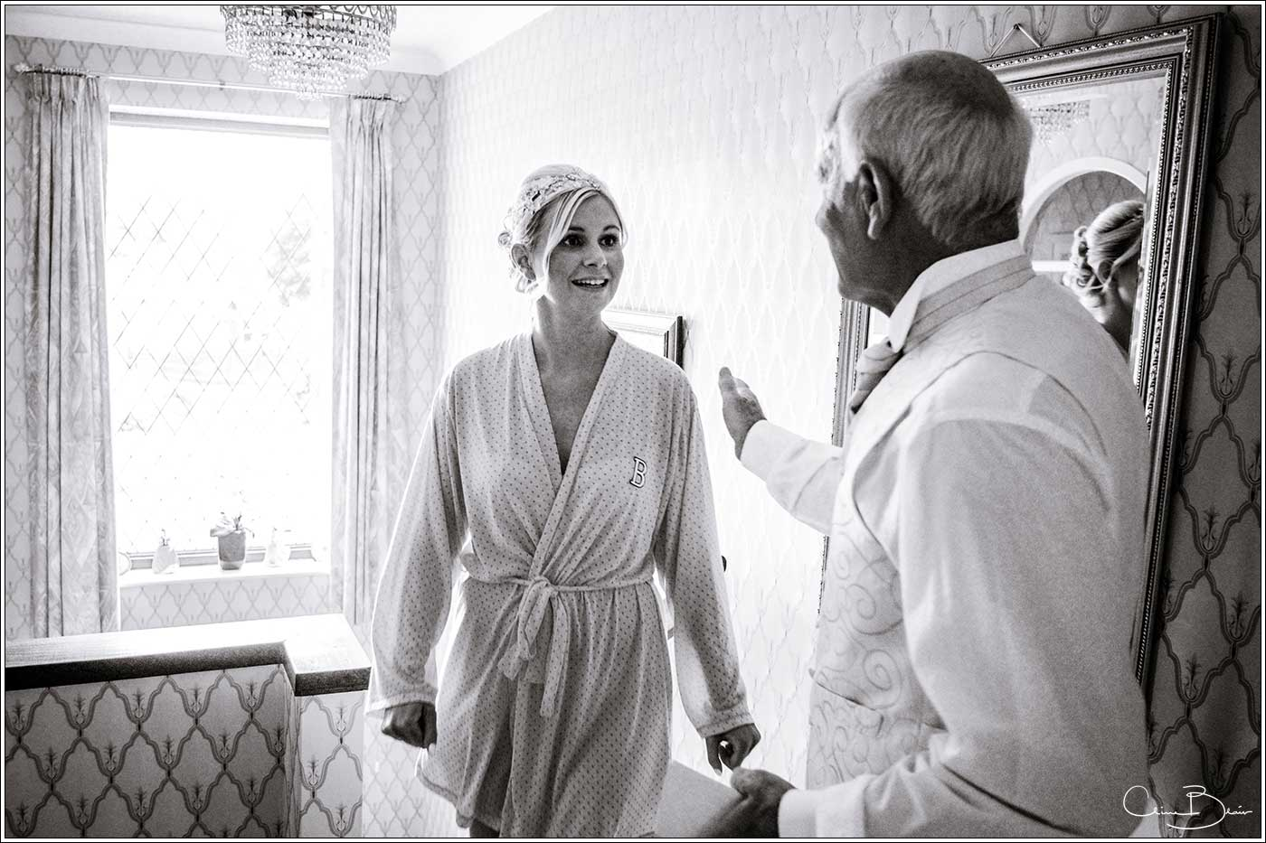 Coombe Abbey wedding photography showing father greeting his daughter before the wedding